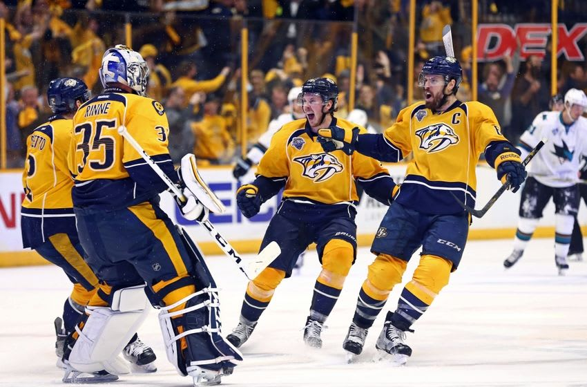May 5, 2016; Nashville, TN, USA; Nashville Predators center Ryan Johansen (left) and defenseman Shea Weber (right) react to defeating the San Jose Sharks during the third overtime period in game four of the second round of the 2016 Stanley Cup Playoffs at Bridgestone Arena. The Predators won 4-3. Mandatory Credit: Aaron Doster-USA TODAY Sports
