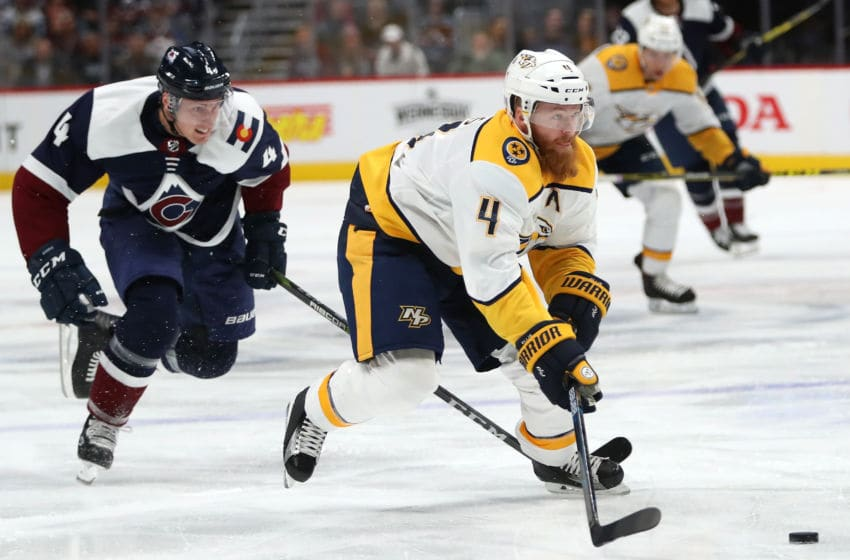 DENVER, CO - NOVEMBER 07: Ryan Ellis #4 of the Nashville Predators races towards the goal on a break away against Tyson Barrie #4 of the Colorado Avalanche at the Pepsi Center on November 7, 2018 in Denver, Colorado. (Photo by Matthew Stockman/Getty Images)