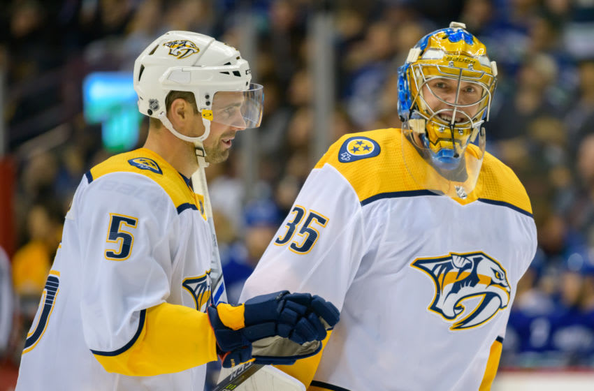 VANCOUVER, BC - DECEMBER 06: Nashville Predators Goalie Pekka Rinne (35) and Nashville Predators Defenceman Dan Hamhuis (5) talk during a stoppage in play during their NHL game against the Vancouver Canucks at Rogers Arena on December 6, 2018 in Vancouver, British Columbia, Canada. Vancouver won 5-3. (Photo by Derek Cain/Icon Sportswire via Getty Images)
