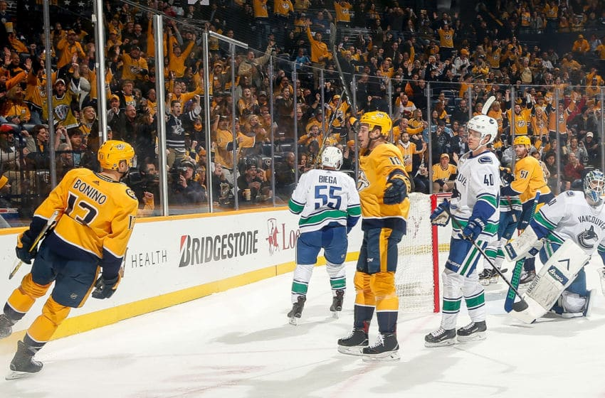 NASHVILLE, TN - DECEMBER 13: Nick Bonino #13 celebrates his goal with Colton Sissons #10 of the Nashville Predators against Anders Nilsson #31 of the Vancouver Canucks at Bridgestone Arena on December 13, 2018 in Nashville, Tennessee. (Photo by John Russell/NHLI via Getty Images)