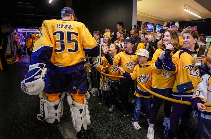 NASHVILLE, TN - FEBRUARY 10: Pekka Rinne #35 of the Nashville Predators taps hands with fans prior to an NHL game against the St. Louis Blues at Bridgestone Arena on February 10, 2019 in Nashville, Tennessee. (Photo by John Russell/NHLI via Getty Images)