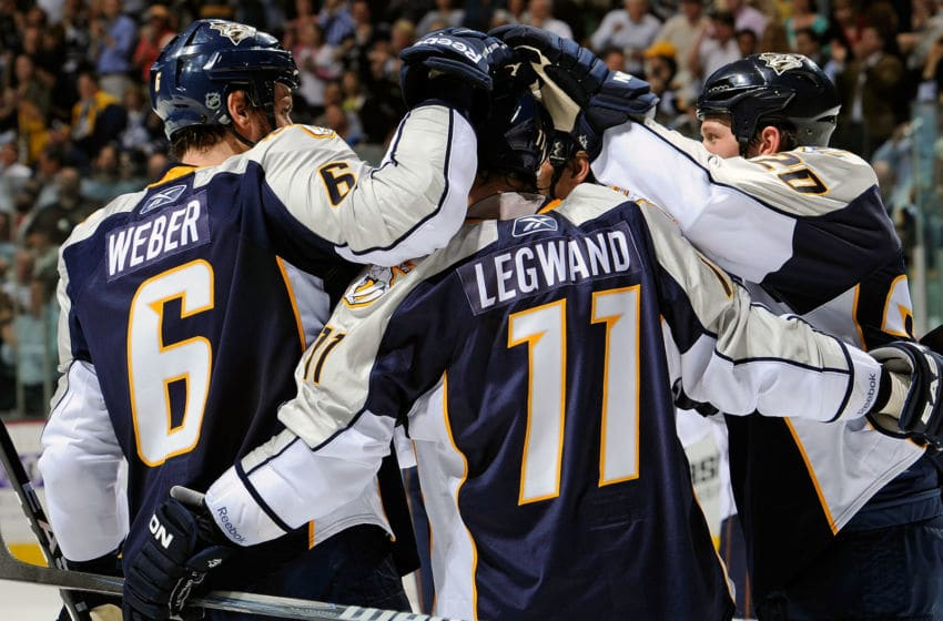 NASHVILLE, TN - MARCH 22: Shea Weber #6 and Ryan Suter #20 of the Nashville Predators congratulate teammate David Legwand Nashville, Tennessee. (Photo by Frederick Breedon/Getty Images)