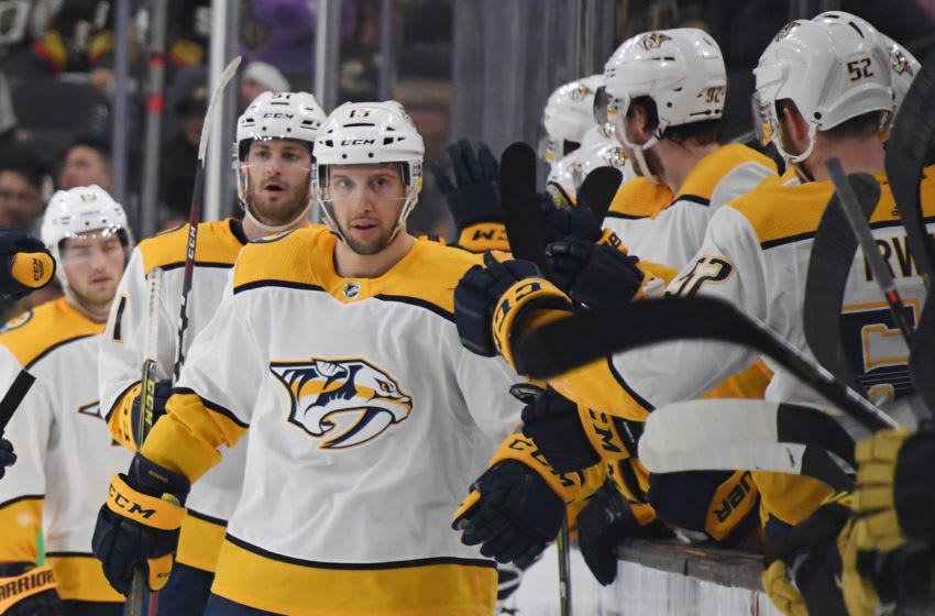 LAS VEGAS, NEVADA - JANUARY 23: Nick Bonino #13 of the Nashville Predators celebrates with teammates on the bench after scoring a second-period goal against the Vegas Golden Knights during their game at T-Mobile Arena on January 23, 2019 in Las Vegas, Nevada. (Photo by Ethan Miller/Getty Images)