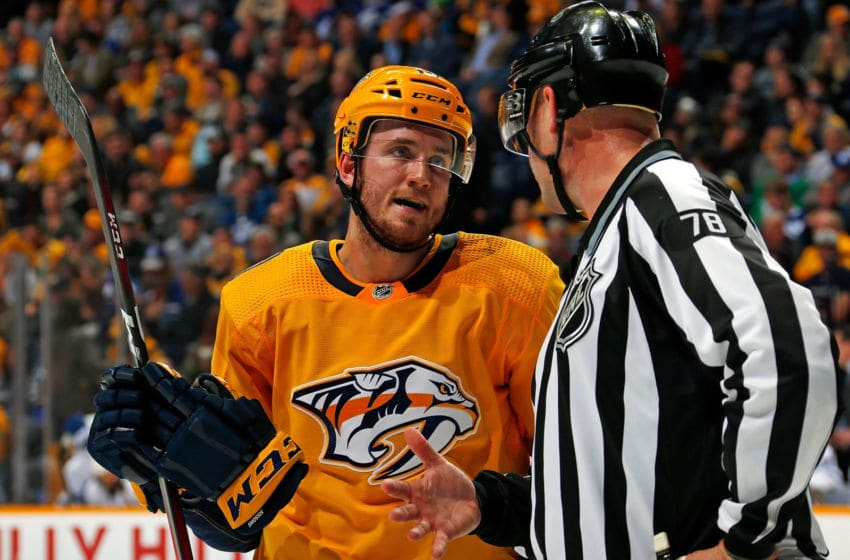 NASHVILLE, TN - MARCH 19: Colton Sissons #10 of the Nashville Predators speaks to official Brian Mach #78 during the third period at Bridgestone Arena on March 19, 2019 in Nashville, Tennessee. (Photo by Frederick Breedon/Getty Images)