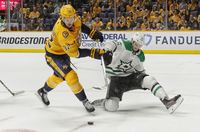 NASHVILLE, TENNESSEE - APRIL 20: Ryan Johansen #92 of the Nashville Predators gets tied up by Jason Dickinson #16 of the Dallas Stars during the third period of a 5-3 Stars victory over the Nashville Predators in Game Five of the Western Conference First Round during the 2019 NHL Stanley Cup Playoffs at Bridgestone Arena on April 20, 2019 in Nashville, Tennessee. (Photo by Frederick Breedon/Getty Images)