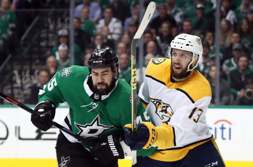 DALLAS, TEXAS - APRIL 22: Roman Polak #45 of the Dallas Stars and Nick Bonino #13 of the Nashville Predators in the second period of Game Six of the Western Conference First Round during the 2019 Stanley Cup Playoffs at American Airlines Center on April 22, 2019 in Dallas, Texas. (Photo by Ronald Martinez/Getty Images)