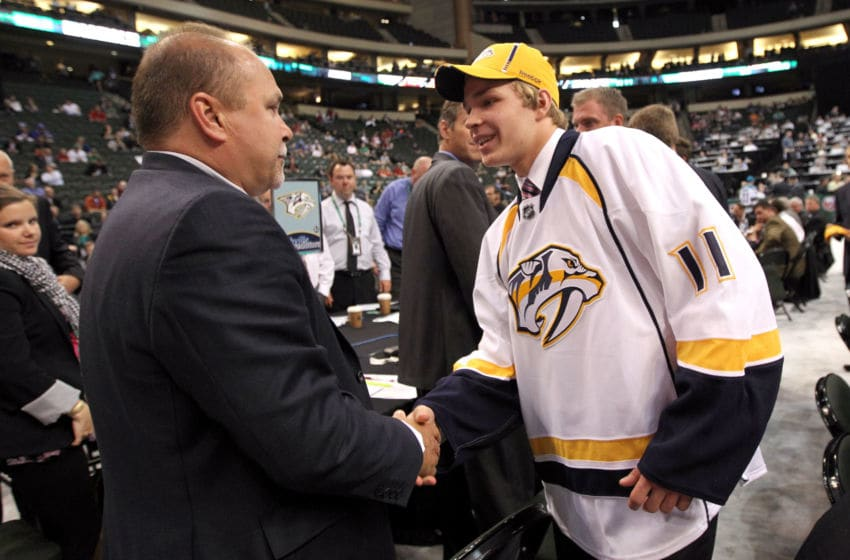 ST PAUL, MN - JUNE 25: Head coach Barry Trotz of the Nashville Predators shakes hands with Miikka Salomaki drafted 52nd overall by the Predators during day two of the 2011 NHL Entry Draft at Xcel Energy Center on June 25, 2011 in St Paul, Minnesota. (Photo by Bruce Bennett/Getty Images)