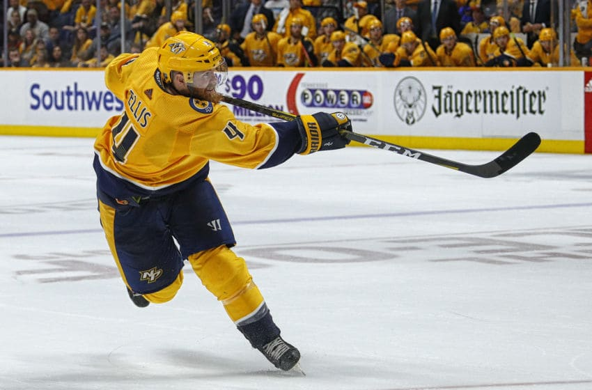 NASHVILLE, TENNESSEE - OCTOBER 10: Ryan Ellis #4 of the Nashville Predators fires a slapshot against the Washington Capitals during the third period of a 6-5 Predators victory over the Capitals at Bridgestone Arena on October 10, 2019 in Nashville, Tennessee. (Photo by Frederick Breedon/Getty Images)