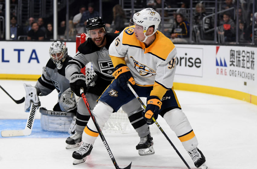 LOS ANGELES, CALIFORNIA - OCTOBER 12: Matt Duchene #95 of the Nashville Predators looks to pass in front of Alec Martinez #27 and Jack Campbell #36 during the third period in a 7-4 Kings win at Staples Center on October 12, 2019 in Los Angeles, California. (Photo by Harry How/Getty Images)