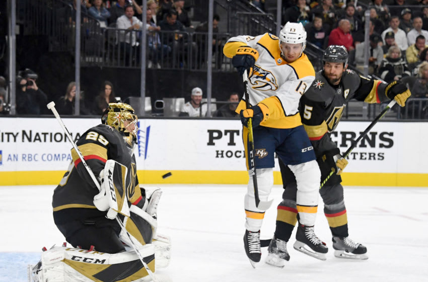 Nick Bonino #13 of the Nashville Predators tips a shot by teammate Kyle Turris (not pictured) (Photo by Ethan Miller/Getty Images)