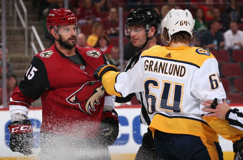 Brad Richardson #15 of the Arizona Coyotes and Mikael Granlund #64 of the Nashville Predators(Photo by Christian Petersen/Getty Images)