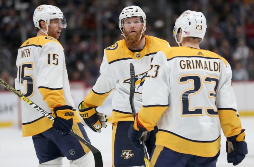 DENVER, COLORADO - NOVEMBER 07: Ryan Ellis #4 of the Nashville Predators celebrates with Rocco Grimaldi #23 and Craig Smith #15 after scoring a goal against the Colorado Avalanche in the third period at the Pepsi Center on November 07, 2019 in Denver, Colorado. (Photo by Matthew Stockman/Getty Images)