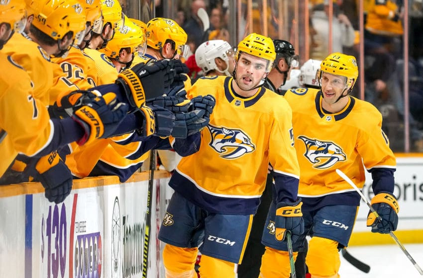 NASHVILLE, TN - DECEMBER 7: Dante Fabbro #57 of the Nashville Predators celebrates his goal against the New Jersey Devils at Bridgestone Arena on December 7, 2019 in Nashville, Tennessee. (Photo by John Russell/NHLI via Getty Images)