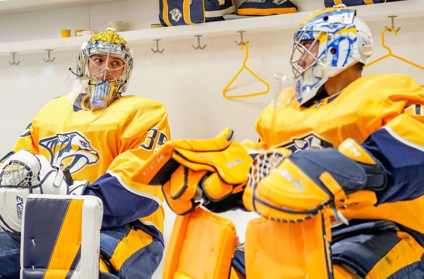 Pekka Rinne #35 and Juuse Saros #74 of the Nashville Predators (Photo by John Russell/NHLI via Getty Images)