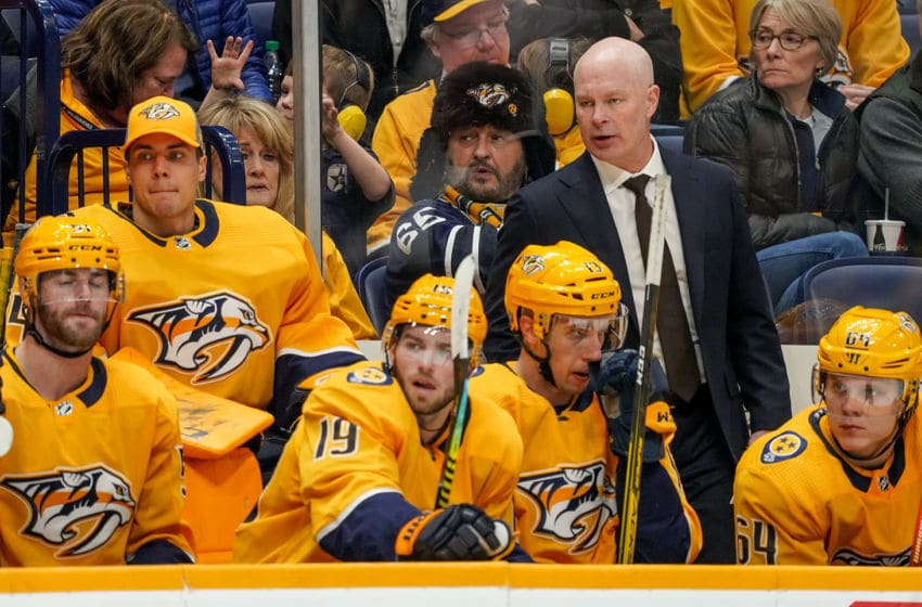 NASHVILLE, TN - JANUARY 7: Nashville Predators head coach John Hynes watches the action against the Boston Bruins at Bridgestone Arena on January 7, 2020 in Nashville, Tennessee. (Photo by John Russell/NHLI via Getty Images)