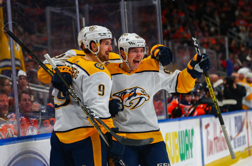 EDMONTON, AB - JANUARY 14: Nashville Predators Left Wing Filip Forsberg (9) celebrates his lacrosse style goal goal with Nashville Predators Center Matt Duchene (95) in the first period during the Edmonton Oilers game versus the Nashville Predators on January 14, 2019 at Rogers Place in Edmonton, AB.(Photo by Curtis Comeau/Icon Sportswire via Getty Images)