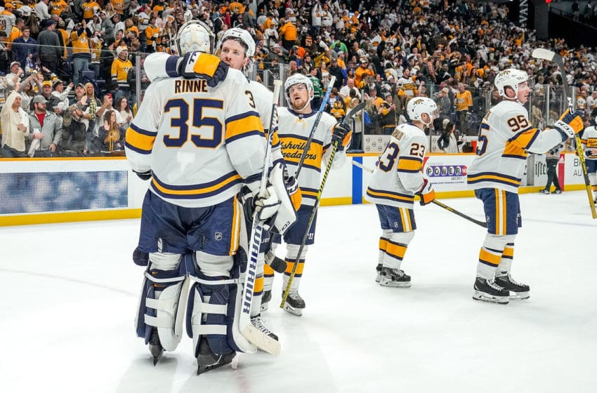 Ryan Johansen #92 congratulates Pekka Rinne #35 of the Nashville Predators (Photo by John Russell/NHLI via Getty Images)