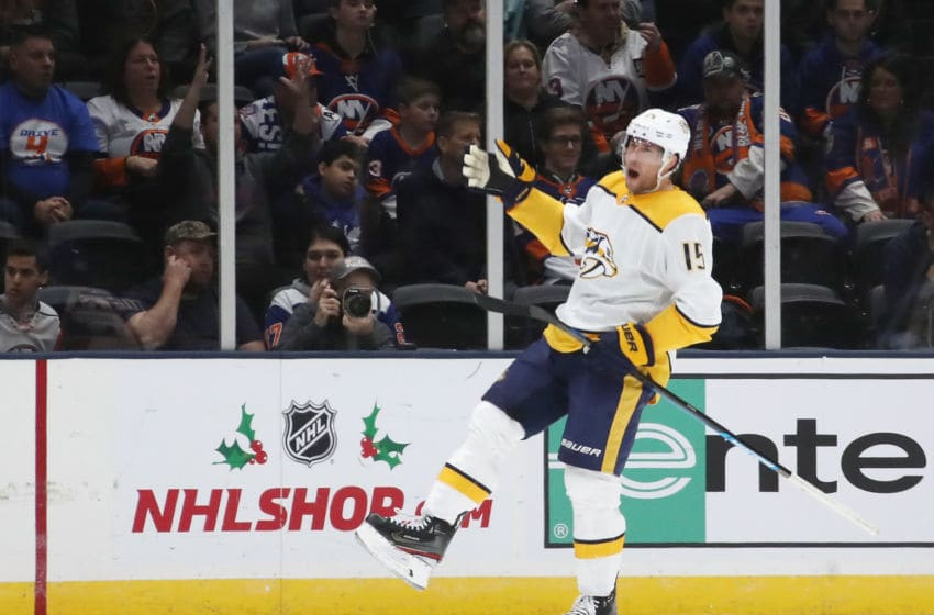 UNIONDALE, NEW YORK - DECEMBER 17: Craig Smith #15 of the Nashville Predators celebrates his goal against the New York Islanders at NYCB Live's Nassau Coliseum on December 17, 2019 in Uniondale, New York. The Predators defeated the Islanders 8-3. (Photo by Bruce Bennett/Getty Images)