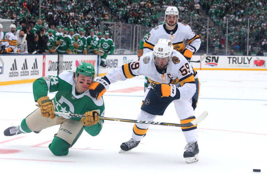 DALLAS, TEXAS - JANUARY 01: Roman Josi #59 of the Nashville Predators and Roope Hintz #24 of the Dallas Stars compete for the loos puck during the Bridgestone NHL Winter Classic at Cotton Bowl on January 01, 2020 in Dallas, Texas. (Photo by Richard Rodriguez/Getty Images)