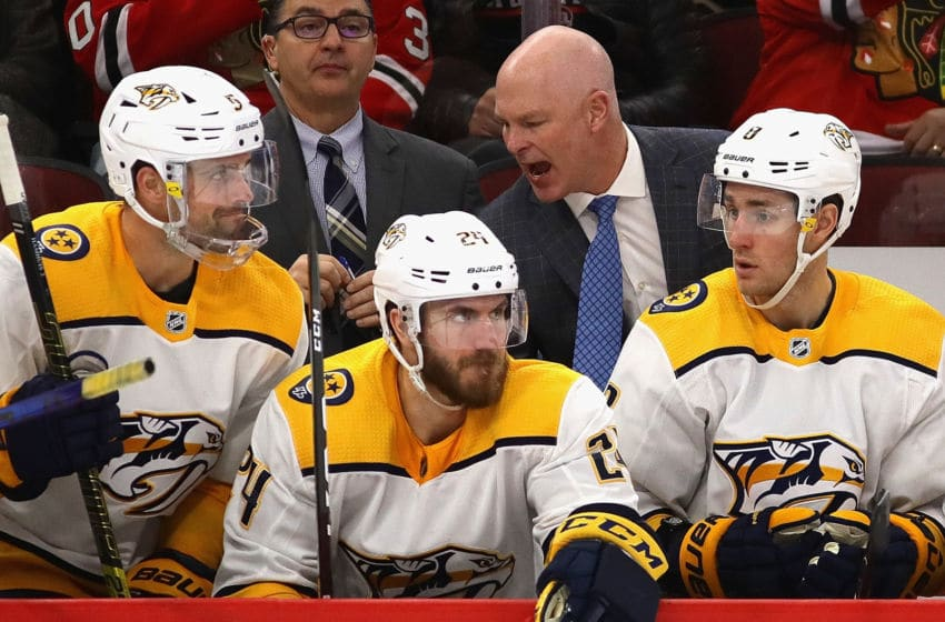 CHICAGO, ILLINOIS - JANUARY 09: Head coach John Hynes of the Nashville Predators gives instructions to players on the bench during a game against the Chicago Blackhawks at the United Center on January 09, 2020 in Chicago, Illinois. The Predators defeated the Blackhawks 5-2. (Photo by Jonathan Daniel/Getty Images)