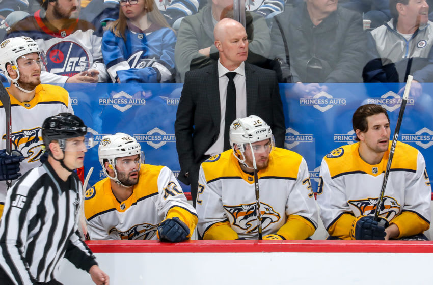 WINNIPEG, MB - FEBRUARY 4: Head Coach John Hynes of the Nashville Predators looks on from the bench during first period action against the Winnipeg Jets at the Bell MTS Place on February 4, 2020 in Winnipeg, Manitoba, Canada. (Photo by Jonathan Kozub/NHLI via Getty Images)
