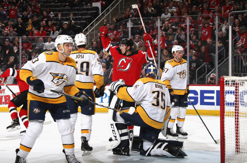 Miles Wood #44 of the New Jersey Devils celebrates a second period power-play goal by Pavel Zacha #37 against Pekka Rinne #35 of the Nashville Predators (Photo by Bruce Bennett/Getty Images)