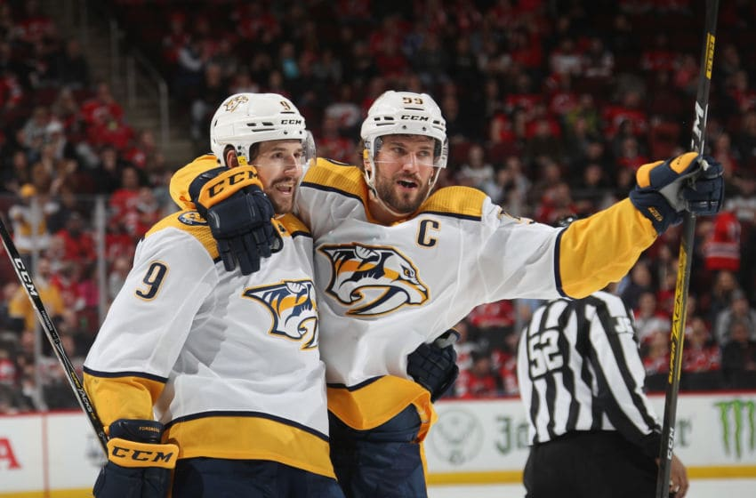 NEWARK, NEW JERSEY - JANUARY 30: (L-R) Filip Forsberg #9 and Roman Josi #59 of the Nashville Predators celebrate Forsberg's third period goal against the New Jersey Devils at the Prudential Center on January 30, 2020 in Newark, New Jersey. The Predators defeated the Devils 6-5 in the shoot-out. (Photo by Bruce Bennett/Getty Images)