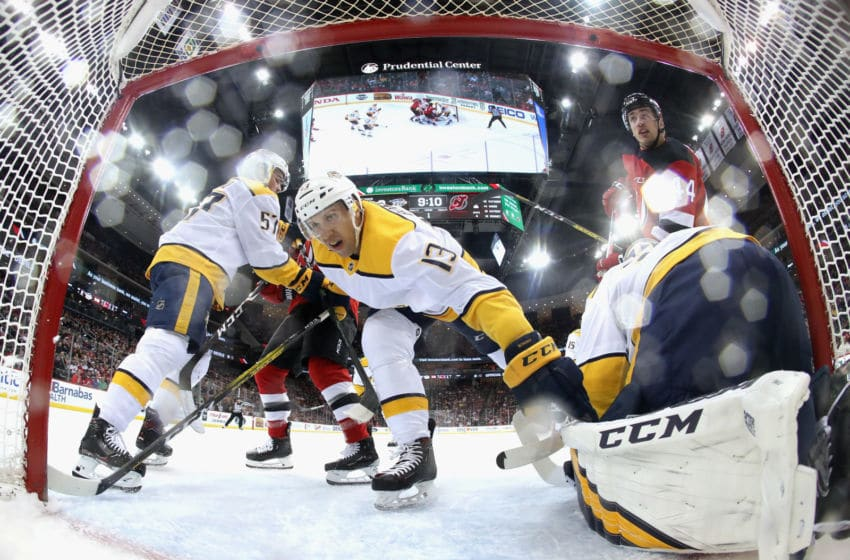 NEWARK, NEW JERSEY - JANUARY 30: Nick Bonino #13 of the Nashville Predators helps defend the net against the New Jersey Devils at the Prudential Center on January 30, 2020 in Newark, New Jersey. The Predators defeated the Devils 6-5 in the shoot-out. (Photo by Bruce Bennett/Getty Images)