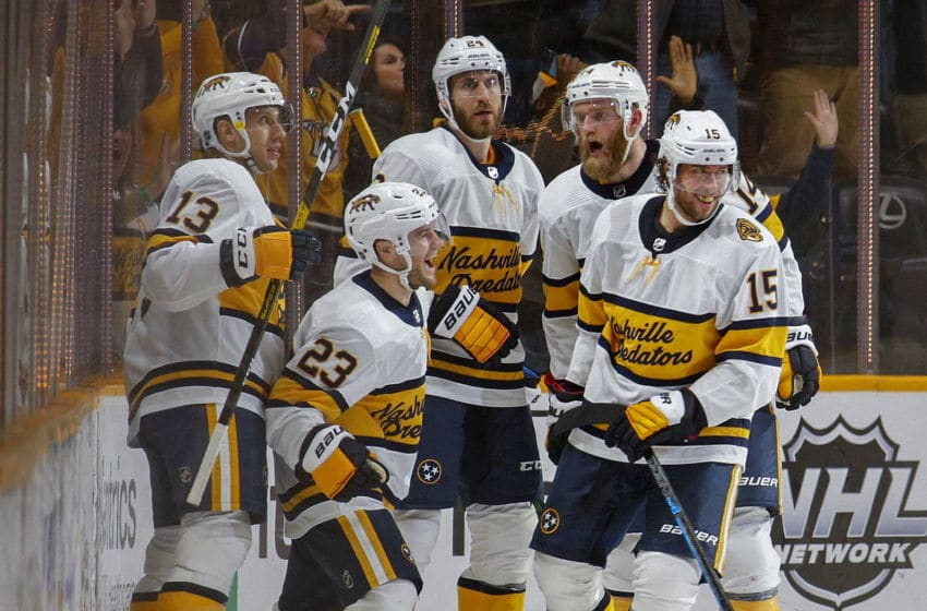 NASHVILLE, TENNESSEE - FEBRUARY 16: Craig Smith #15 of the Nashville Predators celebrates with teammates Nick Bonino #13, Rocco Grimaldi #23, Jarred Tinordi #24 and Mattias Ekholm #14 after scoring a goal against the St. Louis Blues during the second period at Bridgestone Arena on February 16, 2020 in Nashville, Tennessee. (Photo by Frederick Breedon/Getty Images)