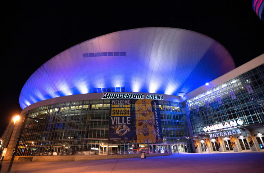 NASHVILLE, TN - APRIL 09: Bridgestone Arena is bathed in blue light on April 09, 2020 in Nashville, Tennessee. Landmarks and buildings across the nation are displaying blue lights to show support for health care workers and first responders on the front lines of the COVID-19 pandemic. (Photo by Jason Kempin/Getty Images)