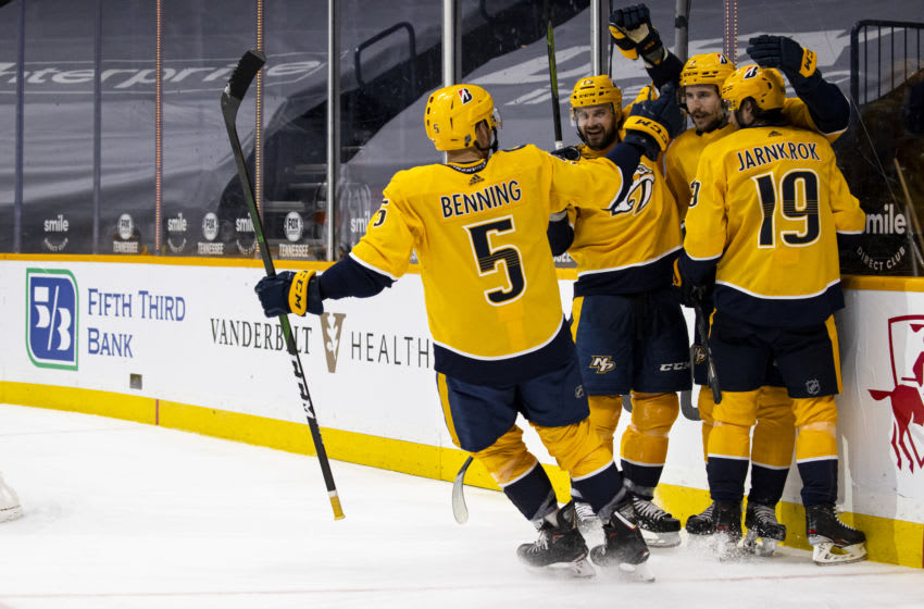 Filip Forsberg #9 of the Nashville Predators (2nd R) celebrates his goal against the Columbus Blue Jackets with teammates during the third period at Bridgestone Arena on January 14, 2021 in Nashville, Tennessee. Nashville defeats Columbus 3-1. (Photo by Brett Carlsen/Getty Images)