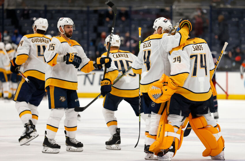 Juuse Saros #74 of the Nashville Predators is congratulated by Ryan Ellis #4 after defeating the Columbus Blue Jackets 4-3 in overtime at Nationwide Arena on May 3, 2021 in Columbus, Ohio. (Photo by Kirk Irwin/Getty Images)