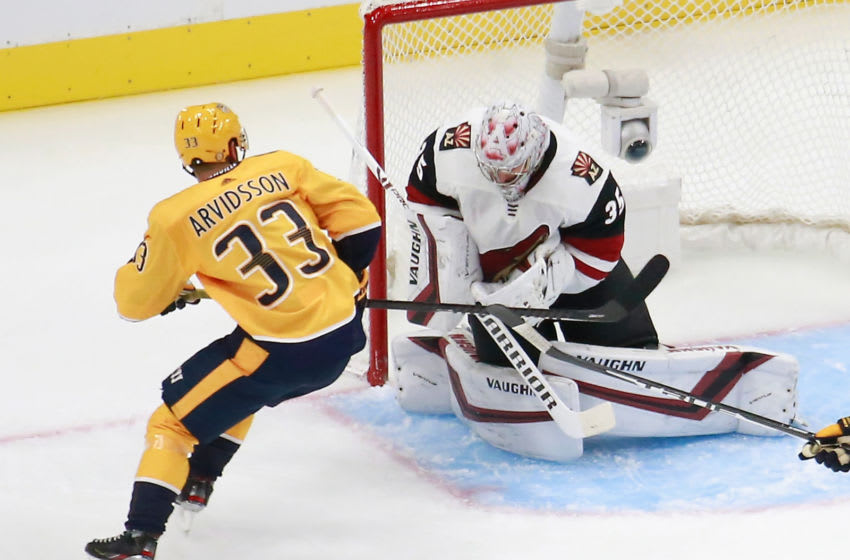 Darcy Kuemper #35 of the Arizona Coyotes makes the first period save as Viktor Arvidsson #33 of the Nashville Predators (Photo by Jeff Vinnick/Getty Images)