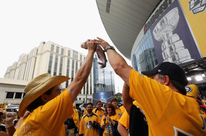 NASHVILLE, TN - JUNE 05: Nashville Predators fans cheer with a catfish prior to in Game Four of the 2017 NHL Stanley Cup Final against the Pittsburgh Penguins at the Bridgestone Arena on June 5, 2017 in Nashville, Tennessee. (Photo by Bruce Bennett/Getty Images)
