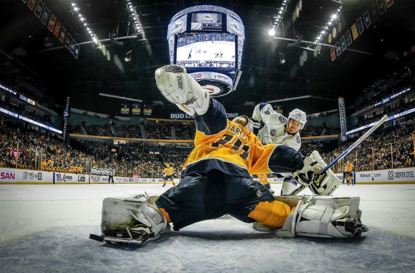 NASHVILLE, TN - JANUARY 23: Chris Kunitz #14 of the Tampa Bay Lightning shoots wide of the net against a sprawling Juuse Saros #74 of the Nashville Predators during an NHL game at Bridgestone Arena on January 23, 2018 in Nashville, Tennessee. (Photo by John Russell/NHLI via Getty Images)