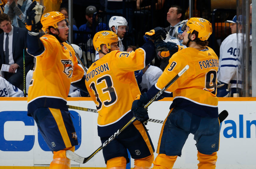 Filip Forsberg #9 of the Nashville Predators is congratulated by teammates Ryan Johansen #92 and Viktor Arvidsson (Photo by Frederick Breedon/Getty Images)