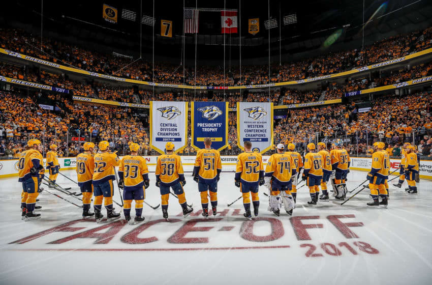 NASHVILLE, TN - OCTOBER 9: The Nashville Predators watch the Presidents' Trophy, Central Division and Western Conference Champions Banner being raised prior to an NHL against the Calgary Flames at Bridgestone Arena on October 9, 2018 in Nashville, Tennessee. (Photo by John Russell/NHLI via Getty Images)