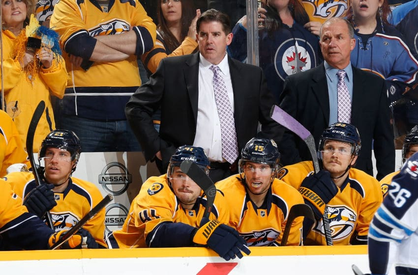 NASHVILLE, TN - NOVEMBER 15: Head coach Peter Laviolette and assistant coach Kevin McCarthy of the Nashville Predators wear lavender ties for Hockey Fights Cancer night against the Winnipeg Jets at Bridgestone Arena on November 15, 2014 in Nashville, Tennessee. (Photo by John Russell/NHLI via Getty Images)