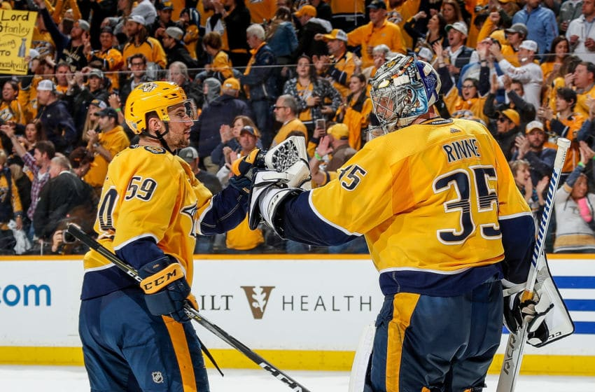 NASHVILLE, TN - APRIL 14: Roman Josi #59 congratulates Pekka Rinne #35 of the Nashville Predators on a 5-4 win against the Colorado Avalanche in Game Two of the Western Conference First Round during the 2018 NHL Stanley Cup Playoffs at Bridgestone Arena on April 14, 2018 in Nashville, Tennessee. (Photo by John Russell/NHLI via Getty Images)