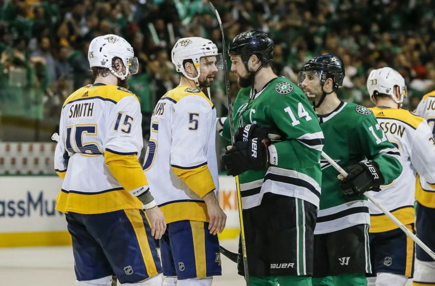 DALLAS, TX - APRIL 22: Dallas Stars left wing Jamie Benn (14) shakes hands with Nashville Predators defenseman Dan Hamhuis (5) after the game between the Dallas Stars and the Nashville Predators on April 22, 2019 at the American Airlines Center in Dallas, Texas. Dallas defeats Nashville 2-1 in overtime. (Photo by Matthew Pearce/Icon Sportswire via Getty Images)