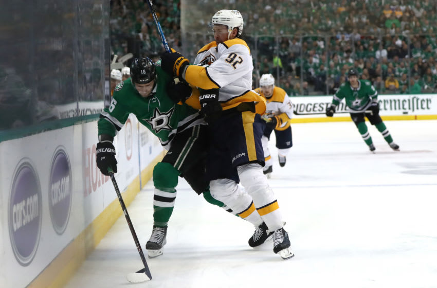 DALLAS, TEXAS - APRIL 17: Jason Dickinson #16 of the Dallas Stars skates the puck against Ryan Johansen #92 of the Nashville Predators in the third period of Game Three of the Western Conference First Round during the 2019 NHL Stanley Cup Playoffs at American Airlines Center on April 17, 2019 in Dallas, Texas. (Photo by Ronald Martinez/Getty Images)