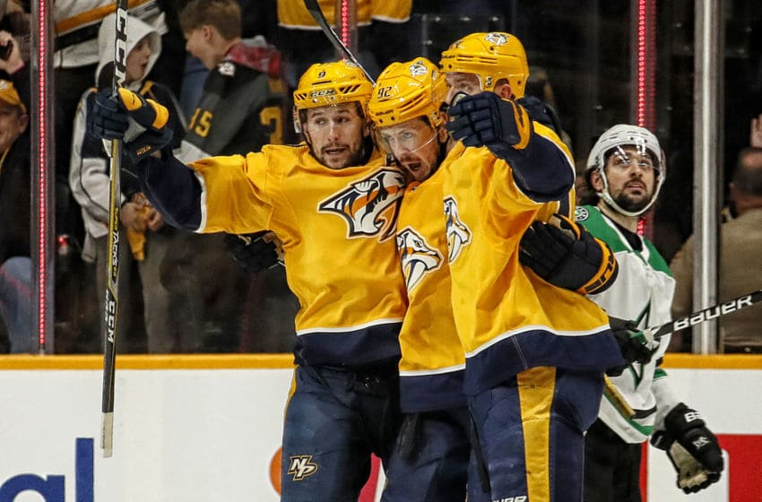 NASHVILLE, TENNESSEE - APRIL 20: Filip Forsberg #9 of the Nashville Predators congratulates teammate Ryan Johansen #92 on scoring a goal against the Dallas Stars during the second period of Game Five of the Western Conference First Round during the 2019 NHL Stanley Cup Playoffs at Bridgestone Arena on April 20, 2019 in Nashville, Tennessee. (Photo by Frederick Breedon/Getty Images)