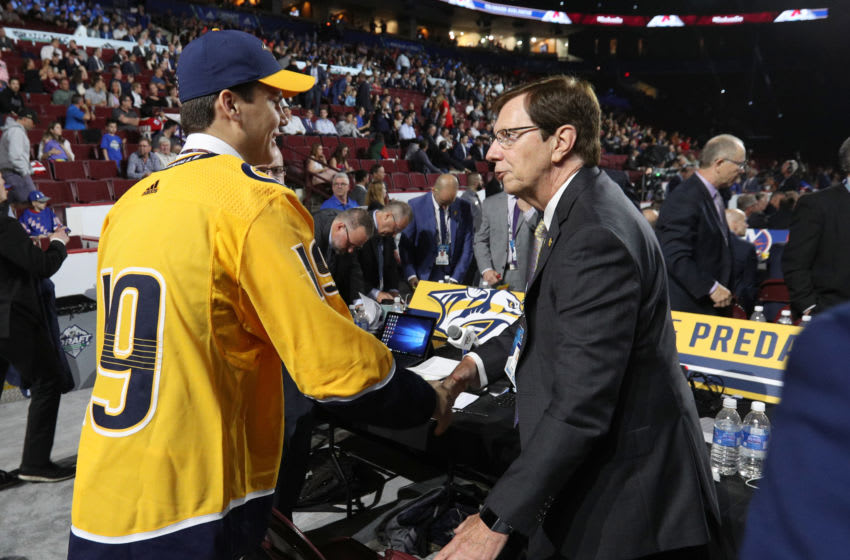 VANCOUVER, BRITISH COLUMBIA - JUNE 22: Egor Afanasyev, 45th overall pick of the Nashville Predators, is greeted at the draft table by general manager David Poile a the team draft table during Rounds 2-7 of the 2019 NHL Draft at Rogers Arena on June 22, 2019 in Vancouver, Canada. (Photo by Dave Sandford/NHLI via Getty Images)