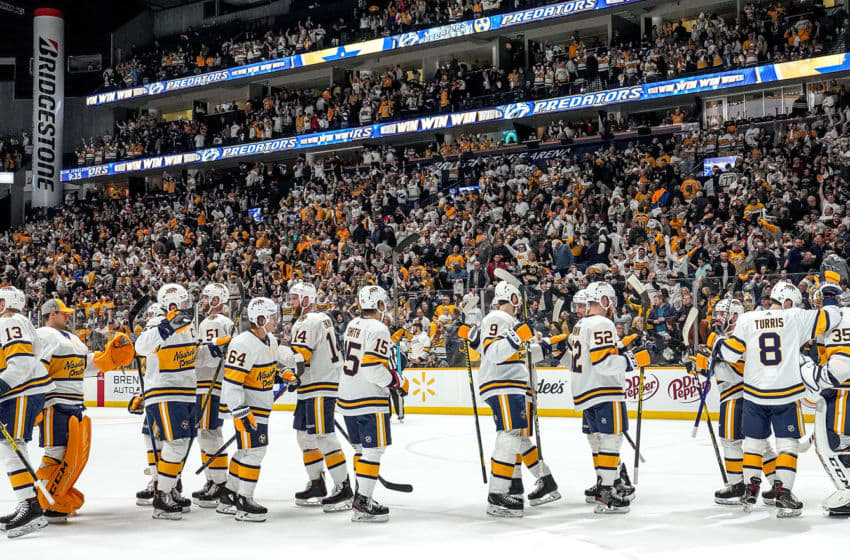 NASHVILLE, TN - JANUARY 18: The Nashville Predators celebrate a 2-1 win against the Buffalo Sabres at Bridgestone Arena on January 18, 2020 in Nashville, Tennessee. (Photo by John Russell/NHLI via Getty Images)