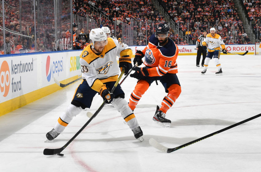 EDMONTON, AB - FEBRUARY 8: Viktor Arvidsson #33 of the Nashville Predators skates with the puck while being pursued by Jujhar Khaira #16 of the Edmonton Oilers on February 8, 2020, at Rogers Place in Edmonton, Alberta, Canada. (Photo by Andy Devlin/NHLI via Getty Images)