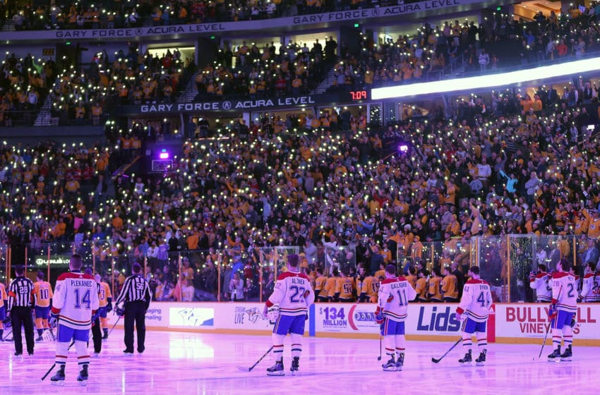 NASHVILLE, TN - NOVEMBER 22: Fans of the Nashville Predators hold their phone lights on with members of the Montreal Canadiens to stand together for a moment of silence to show support of Hockey Fights Cancer prior to a game between the Montreal Canadiens and the Nashville Predators at Bridgestone Arena on November 22, 2017 in Nashville, Tennessee. (Photo by Frederick Breedon/Getty Images)