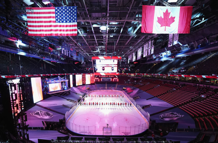 TORONTO, ONTARIO - JULY 29: The Tampa Bay Lightning and the Florida Panthers stand at attention for the national anthems prior to their exhibition game before the 2020 NHL Stanley Cup Playoffs at Scotiabank Arena on July 29, 2020 in Toronto, Ontario, Canada. (Photo by Andre Ringuette/Freestyle Photo/Getty Images)