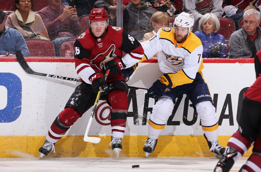 Christian Fischer #36 of the Arizona Coyotes and Yannick Weber #7 of the Nashville Predators (Photo by Christian Petersen/Getty Images)