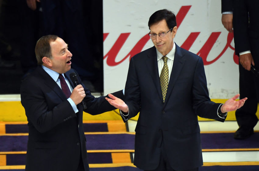 Nashville Predators general manager David Poile (right) is honored by NHL Commissioner Gary Bettman for being the winningest general manager in NHL history before a game between the Predators and the Anaheim Ducks at Bridgestone Arena. Mandatory Credit: Christopher Hanewinckel-USA TODAY Sports