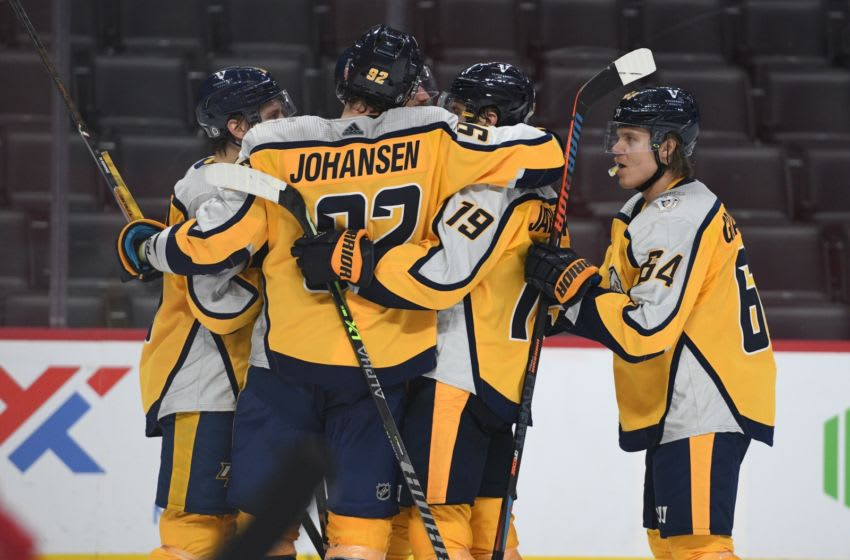 Nashville Predators center Mikael Granlund (64) celebrates his goal with teammates during the third period against the Detroit Red Wings at Little Caesars Arena. Mandatory Credit: Tim Fuller-USA TODAY Sports